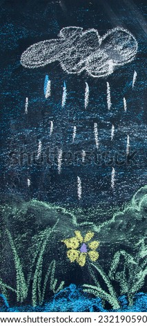 rain drawing made by a small child on a blackboard - stock photo