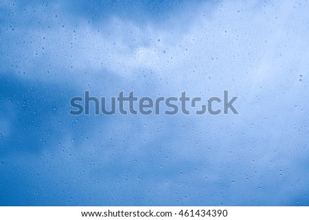 rain drop on glass with sky background