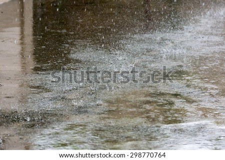 Rain droplets on a cement floor - stock photo