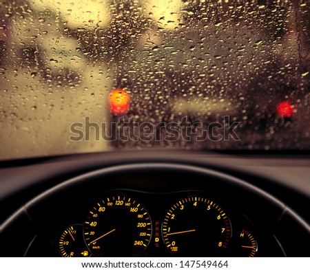rain droplets on car windshield, blocked traffic  - stock photo
