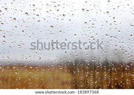 Rain drops on a window - stock photo