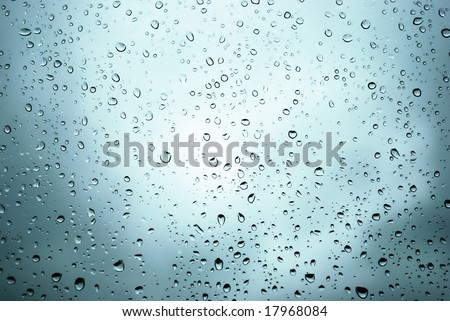 rain drops on a window and mystic silhouette of city - stock photo