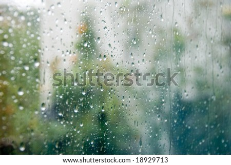 Rain drops on a window, blurry background.