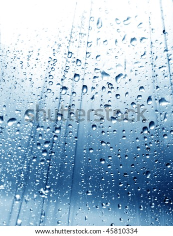 Rain drops on blue background