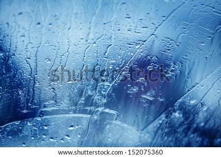 rain drops on car glass - stock photo
