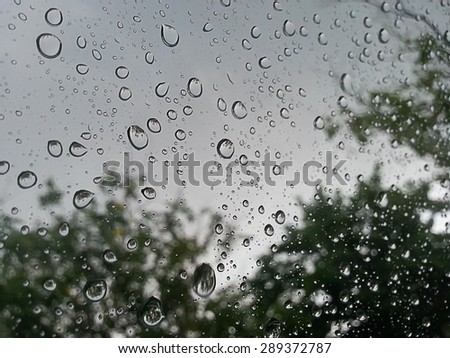 rain drops on car glass in rainy day