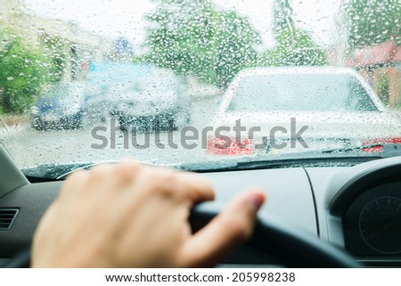 rain drops on car glass in rainy days - stock photo