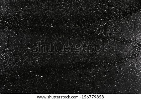 Rain drops on dark glass - stock photo