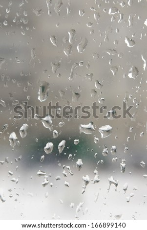 Rain drops on the window. Abstract background. Shallow DOF.