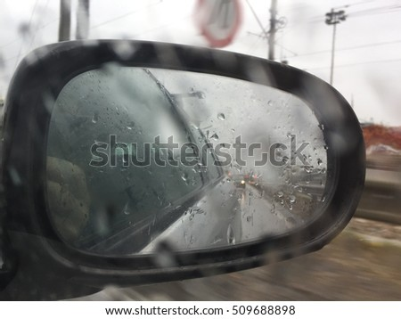 rain drops on the window with traffic light