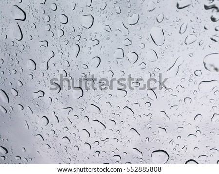 Rain drops on the windshield with sky in background