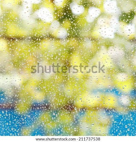 rain drops on window glass after summer shower background - stock photo