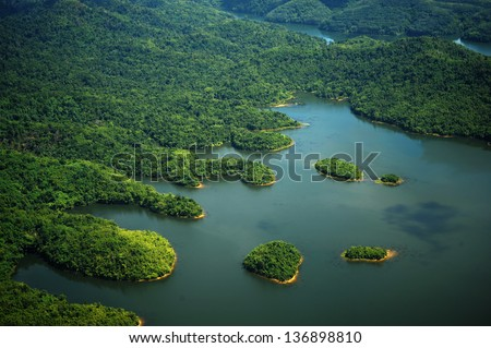 Rain Forest mountain and lake, Kedah Malaysia - arial view - stock photo