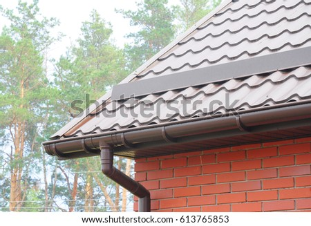 Gutter stock images royalty free images vectors for House roof drain pipes