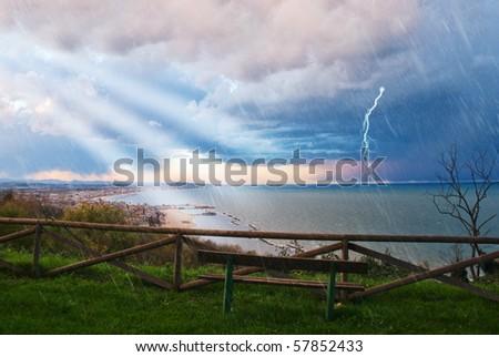 rain in summer on the sea - stock photo