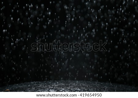 Rain on a black background. Abstract background - stock photo