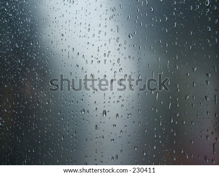 Rain on curved steel - stock photo
