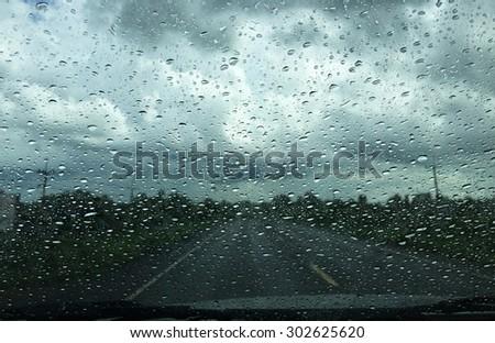Rain on dashboard window car - stock photo