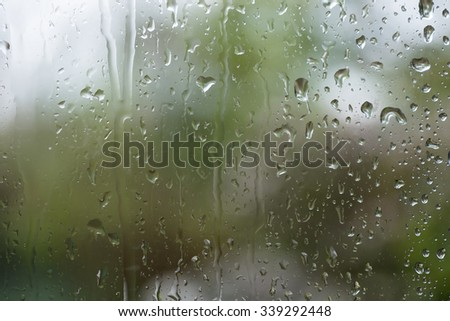 Rain on glass with green - stock photo