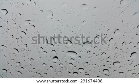 Rain on the glass car - stock photo