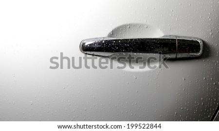 Rain on White Car Door  - stock photo