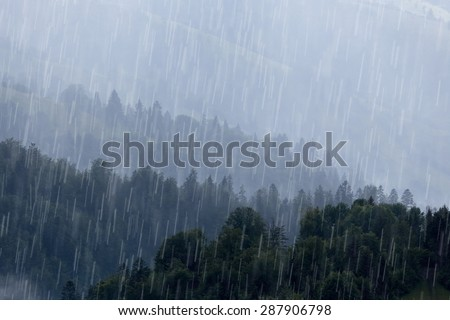 Rain over forest mountains. - stock photo