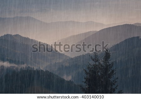 Rain over forest mountains. Misty mountain landscape hills at rainy day. - stock photo