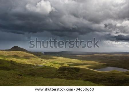 Rain shower over Isle of Skye - stock photo