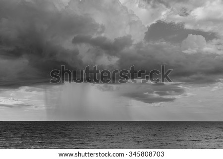 Rain storms are happening at sea.(Black and White)