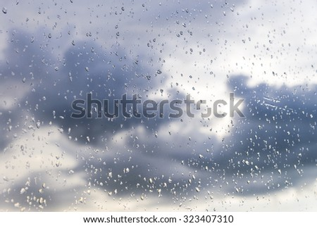 Rain / Water drop of rain on glass with outdoor background - stock photo