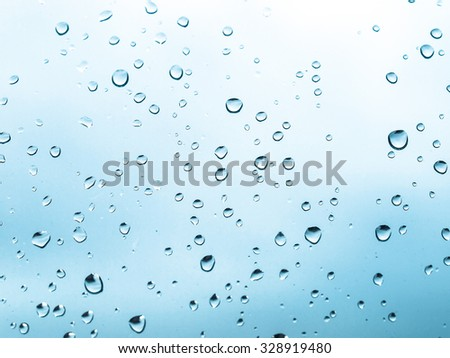 Rain water droplets useful as a background - cool cold tone - stock photo