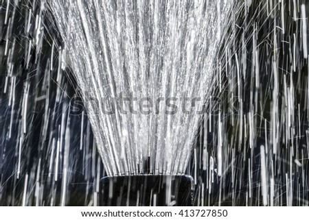 rain water drops close up in detail - fountain - stock photo
