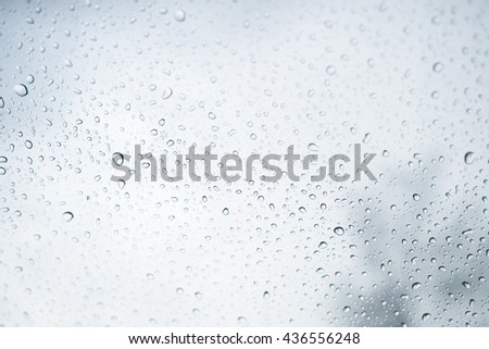 Rain water drops on a glass , Abstract Backdrop vintage style. - stock photo