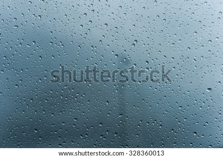 Rain Water drops on mirror  background