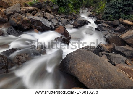 Rain water flowing at Tamhini Ghat, Pune, Maharashtra, India ,August 20, 2013 - stock photo