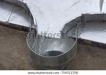 Rain Water Flows Down The Roof Into The Drain, Material Tin, Rainy Weather