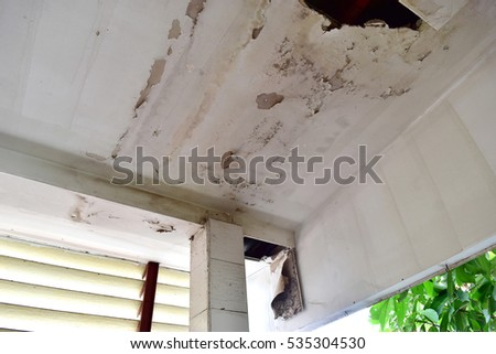 Rain water leaks on the ceiling causing damage, tiles and gypsum board.