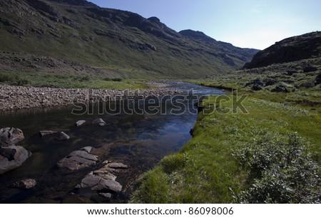 Rain water river in arctic tundra, Greenland - stock photo