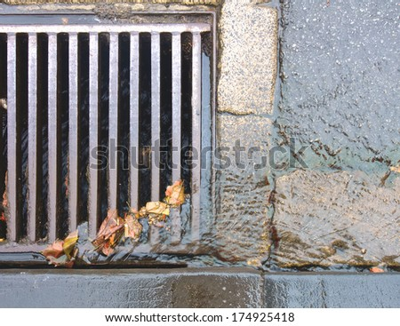 rain water running down a gutter on a stormy day - stock photo