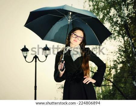 Rain. Woman with umbrella on the street - stock photo
