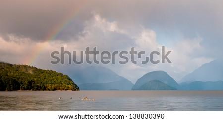 Rainbow above Manapouri lake along the Kepler track - stock photo