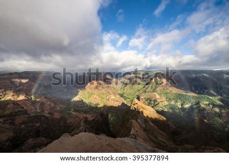 Rainbow according to the Waimea Canyon, Kauai, Hawaii - stock photo