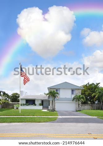 Rainbow American Flag Pole over Suburban Back Split Style home in residential neighborhood USA Blue Sky Clouds - stock photo