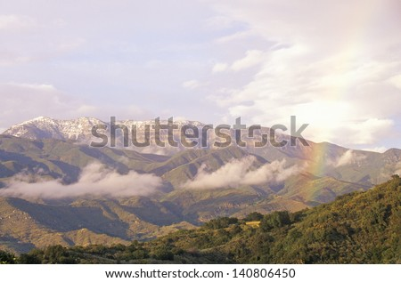 Rainbow and clouds over the Topa Topa Mountains in Ojai, California - stock photo