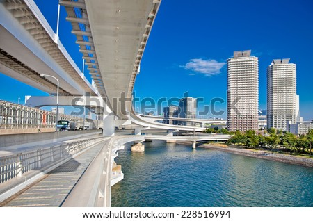 Rainbow Bridge and Sumida River in Tokyo, Japan. This landmark bridge carries many transit lines, as well as vehicle traffic. - stock photo