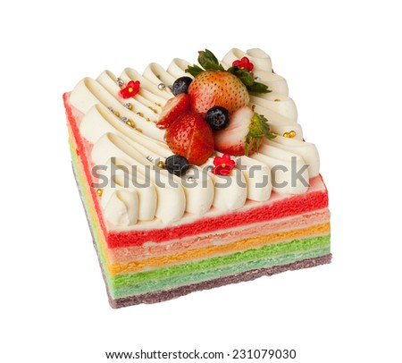 Rainbow cake with strawberry toppings isolated on white background  - stock photo