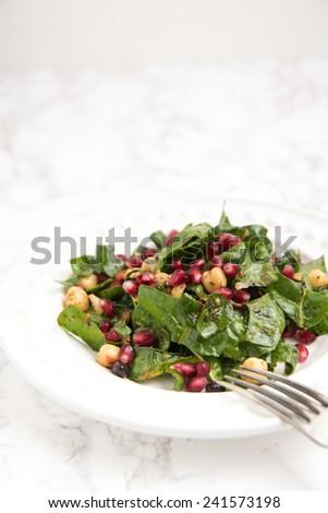 Rainbow Chard, Chickpea, and Pomegranate Salad - stock photo