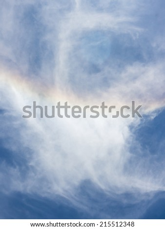 Rainbow ,clouds and blue sky view from above - stock photo