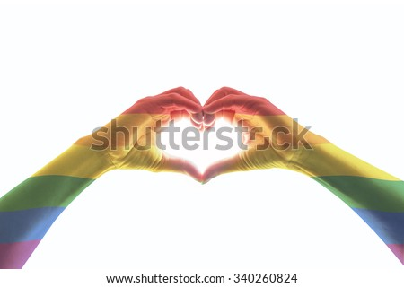 Rainbow color flag pattern on woman human hands forming in heart shape isolated on white background: Symbolic equal rights in love and marriage social equality of LGBT community/ people concept    - stock photo