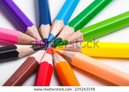 Rainbow color pencils set round isolated on white - stock photo